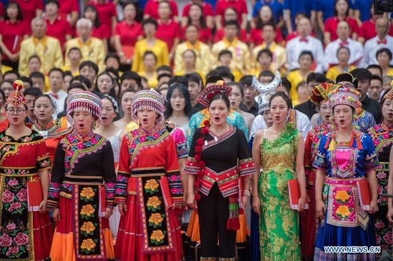 People take part in chorus performance to celebrate upcoming National Day