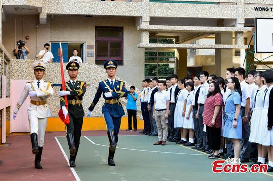 PLA honor guards hold flag-raising ceremony at Hong Kong school